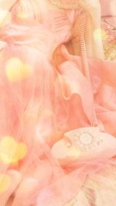 【ピンクの待ち受け】ピンクの電話で連絡が来る、恋の願いが叶う背景画像